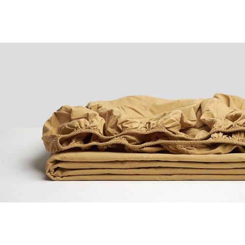 Sabana bajera ajustable cama 150cm percal liso mostaza w.g.
